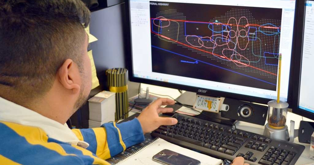 Applications Engineer, Carlos Alvarenga, works on a lighting layout for DECO.